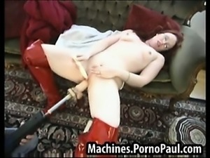 Kinky redhead fucked by machines
