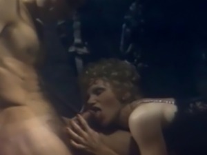 In a scene from the 1981 movie Blue Magic, Candida Royalle and her fuck...