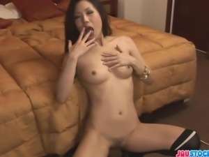 Tight and smoking hot Japanese milf dressed in a sexy white top and black...