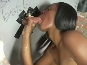 Dena gives gloryhole blowjob