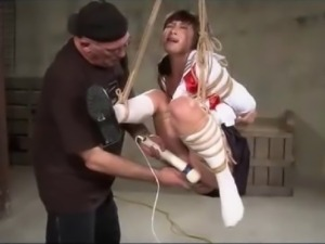 Suspended Asian schoolgirl spanked and made to orgasm