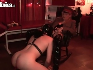 Evil mistress tortures her pathetic slave
