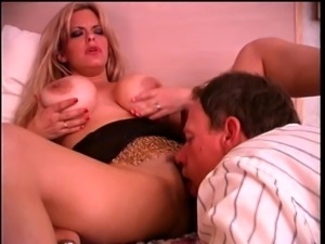 Long-haired d-cup blonde sucks business dude's cock then fucks him with...