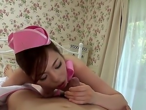 Japanese mommy Emi Sasaki in sexy pink uniform gives sensual slow blowjob...