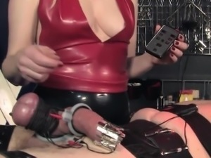 Fetish cbt mistress in latex closeup with sub