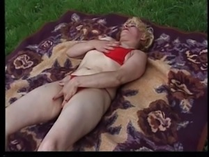 Mature blonde skank in red lingerie fucks herself