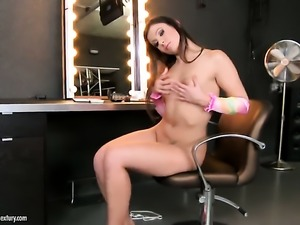 Brunette fills the hole between her legs with sex toy for cam in solo scene