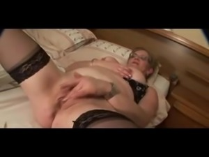 Granny in glasses and stockings (big nipples) masturbates