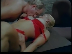 Vintage big boobs takes two cocks for cum on face.
