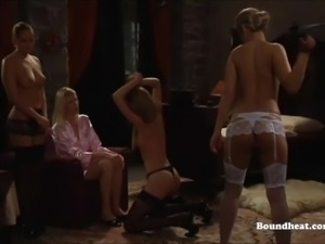 Hot lesbian mistress whips beautiful white slave