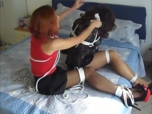 Hogtied slaves tortured on bed