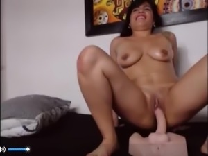 Latino rides big sex toy