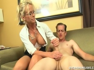 Kinky blonde wife offers a young man a wonderful handjob on the couch