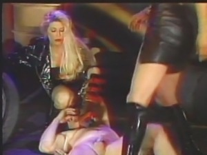Femdom hard latex boots play with slave