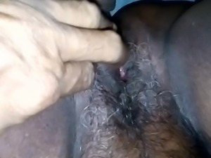 Fingering wet and hairy pussy