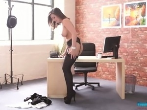 Oversexed secretary Charlie Rose shows off her adorable slit and sexy stockings