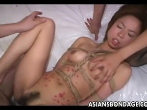 Asian slut waxed up tied up and threesomed