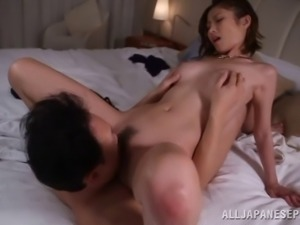 Dainty Asian babe with natural tits swallows cum after getting her hairy...