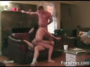 Amateur housewife is shagged by two guys on the leather sofa