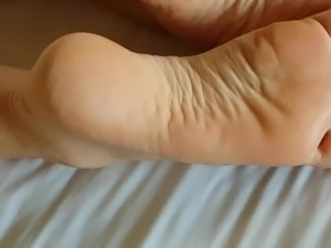 Cum shot on sexy soles of her feet