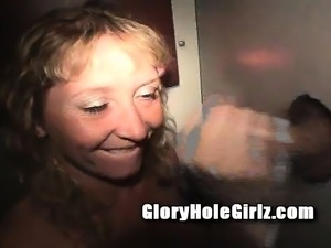Beautiful blonde with big hooters milks gloryhole dicks with her lips