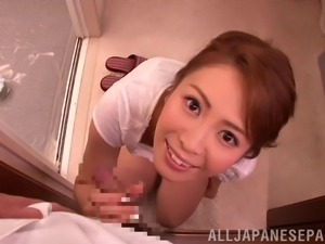 Japanese bitch housewife on her knees milking a cock
