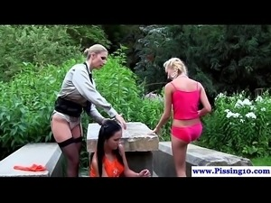 Outdoor peeing lesbians toying pussys