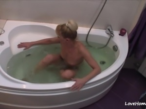 Nerdy blonde gets naked and takes a bath