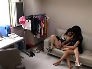 Striking Japanese girl has her lesbian friend fingering her