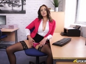Sweet and sexy redhead office girl at work flashes her pink panties