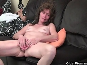 Sleazy grandma with saggy tits finger fucks hairy cunt