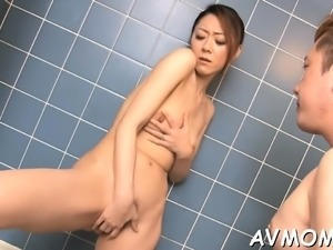 Sexy asian mom undresses and her taut pussy finger drilled