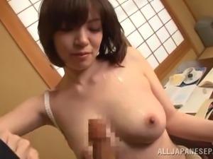 Japanese mom Nao Mizuki enjoys sucking and titfucking a shaft