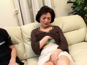 Horny Japanese mom has a young guy fulfilling her desires