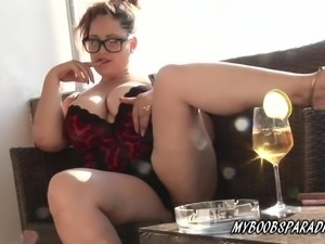 Busty Crazy Maria on balcony show tits and smoking cigar