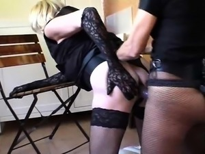Crossdresser in lingerie gets fucked with a strap-on toy