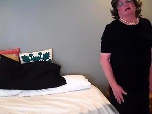 Hot mature crossdresser in stockings masturbates on the bed