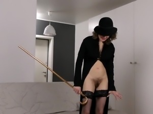 Ardent all alone woman Princess Mustang pets herself with a cane